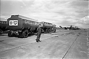 26/06/1963<br /> 06/26/1963<br /> 26 June 1963<br /> Irish Shell and BP Leyland fuel tankers for the helicopters of President John F. Kennedy under guard at Dublin Airport. Soldiers name is Eatz.