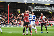 Brentford Defender Yoann Barbet (29) and Queens Park Rangers Midfielder Pawel Wszolek (23) in action during the EFL Sky Bet Championship match between Brentford and Queens Park Rangers at Griffin Park, London, England on 2 March 2019.