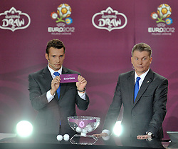 (L) ANDRIY SCHEVCHENKO AND (R) OLEG BLOCHIN (BOTH UKRAINE) SHOW THE TICKET OF SLOVENIA DURING THE UEFA EURO 2012 QUALIFYING DRAW IN PALACE SCIENCE AND CULTURE IN WARSAW, POLAND..THE 2012 EUROPEAN SOCCER CHAMPIONSHIP WILL BE HOSTED BY POLAND AND UKRAINE...WARSAW, POLAND , FEBRUARY 07, 2010..( PHOTO BY ADAM NURKIEWICZ / MEDIASPORT / SPORTIDA.COM )