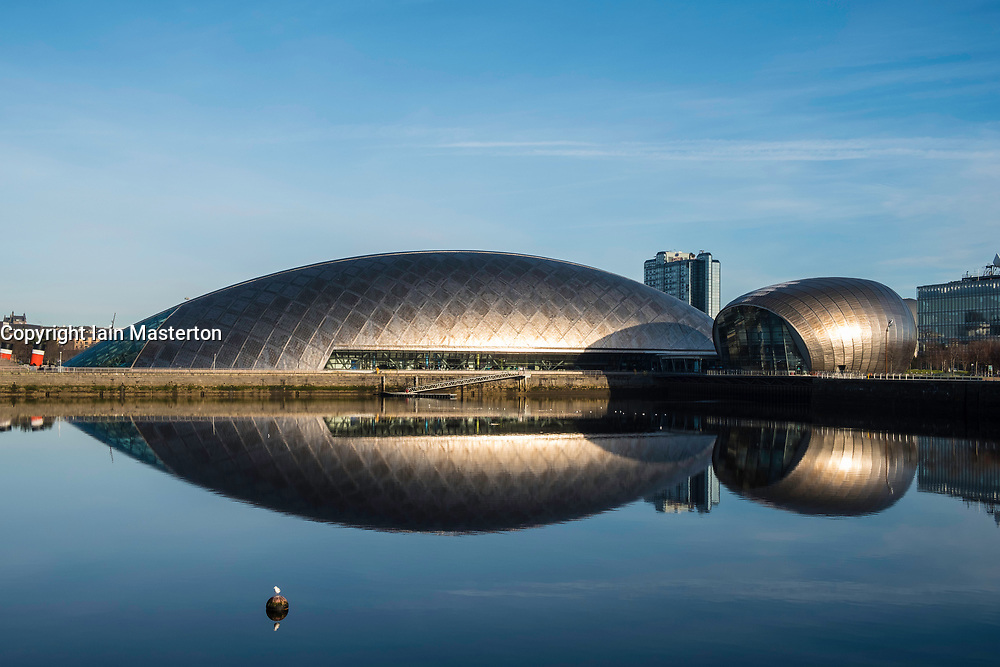 View of Glasgow Science Centre North Quay and IMAX Cinema beside River Clyde on blue sky wintery, Scotland, United Kingdom