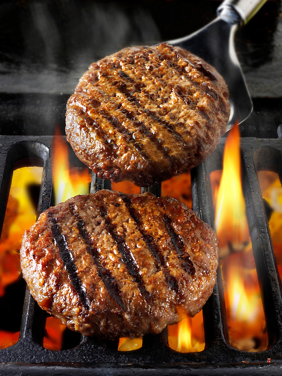 Beef burgers being cooked. Food photos, pictures & images.