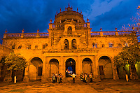 A group of musicians perform at twilight outside the entrance of the Cabañas Cultural Institute in the historic center of Guadalajara, Mexico