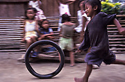 In the village of Busok Busok village poor children play with whatever comes to hand to have fun in the hours when they are not at school, Aurora province, Philippines