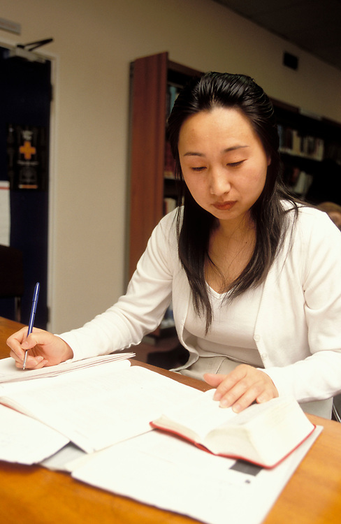 Asian student studying in library; University of Westminster; UK