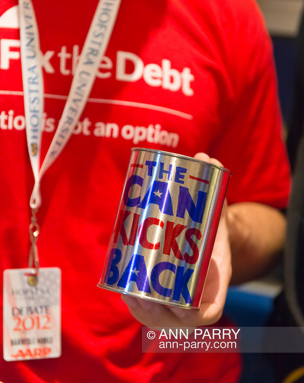 """Oct. 15, 2012 - Hempstead, New York, U.S. - Fix the Debt Campaign literature, can with """"The Can Kicks Back"""" slogan, and more are on table in lobby of Hofstra University's John Cranford Adams Playouse, while the campaign's co-founders, Simpson and Bowles, speak in the auditorium about ?America's Debt and Deficit Crisis: Issues and Solutions.? This event with the co-chairmen of the National Commission on Fiscal Responsibility and Reform, and co-leaders of Simpson-Bowles non-partisan U.S. fiscal debt reduction plan, was part of """"Debate 2012 Pride Politics and Policy"""" a series of events leading up to when Hofstra hosts the 2nd Presidential Debate between Obama and M. Romney, the next night, October 16, 2012, in a Town Meeting format."""