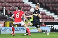 Alex Fisher (18) of Yeovil Town takes on James Dunne (8) of Swindon Town during the EFL Sky Bet League 2 match between Swindon Town and Yeovil Town at the County Ground, Swindon, England on 10 April 2018. Picture by Graham Hunt.