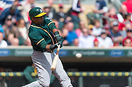 Yoenis Cespedes #52 of the Oakland Athletics bats against the Minnesota Twins on April 9, 2014 at Target Field in Minneapolis, Minnesota.  The Athletics defeated the Twins 7 to 4.  Photo by Ben Krause