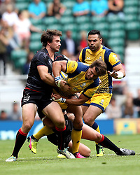 Dean Hammond of Worcester Warriors is tackled by Marcelo Bosch of Saracens - Mandatory by-line: Robbie Stephenson/JMP - 03/09/2016 - RUGBY - Twickenham - London, England - Saracens v Worcester Warriors - Aviva Premiership London Double Header