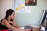 Paralegal Romina Kajtazova at her working place at NGO Kham preparing the lecture for Crnik which will be later that day.