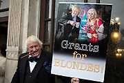 Pro Brexit Leave supporter and Boris Johnson lookalike, with his grants for blondes Jennifer Arcuri placard  in Westminster on Brexit Day as the UK prepares to leave the European Union on 31st January 2020 in London, England, United Kingdom. At 11pm on Friday 31st January 2020, The UK and N. Ireland will officially leave the EU and go into a state of negotiations as to the future arrangement and trade agreement, while adhering to EU rules until the end of 2020.