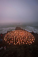 Luminaries light up the Lands End Labyrinth overlooking the Pacific Ocean surf  - San Francisco, California