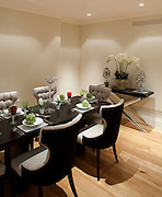dining table laid for dinner in a showroom house