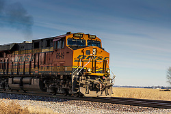 BNSF (Burlington Northern Santa Fe) RR 6949 Locomotive travels through a crossing north of Ancona Illinois on January 23rd, 2021 in the early afternoon.  Locomotive 6949 was built in October 1978 and is an EMD SD40-2 model enginge.