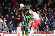 Tom Elliott forward for AFC Wimbledon (9) and Luke Wilkinson defender of Stevenage FC (2) during the Sky Bet League 2 match between Stevenage and AFC Wimbledon at the Lamex Stadium, Stevenage, England on 30 April 2016. Photo by Stuart Butcher.