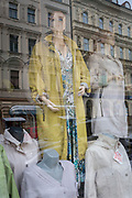 Fading ladies' fashions in a shop window in on Milady Horakove street, Holesovice district, Prague 7, on 18th March, 2018, in Prague, the Czech Republic.