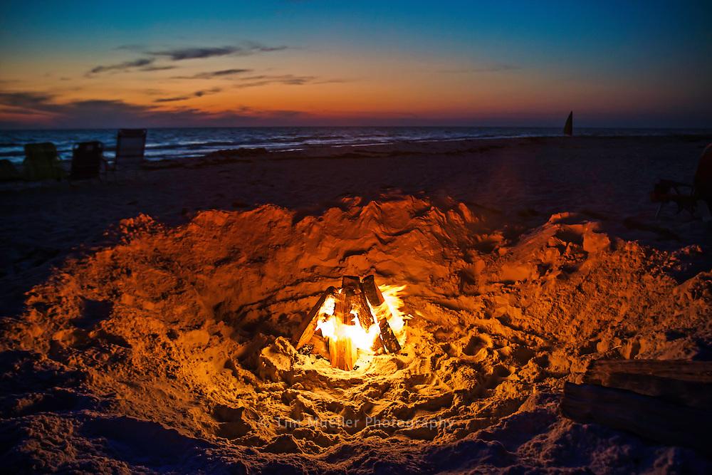 Sunset and bonfire at the beach at Cape San Blas Florida.