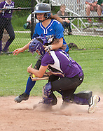 Middletown, New York - A Middletown baserunner collides with the Warwick catcher at home plate during a varsity girls' softball game on May 27, 2014.