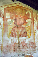 Religious mural of St Christopher with Christ on his shoulders by Dionislo Baschenis, dated 1493, on the exterior of the Gothic Church of San Antonio Abate,  Pelugo, Province of Trento, Italy .<br /> <br /> Visit our ITALY PHOTO COLLECTION for more   photos of Italy to download or buy as prints https://funkystock.photoshelter.com/gallery-collection/2b-Pictures-Images-of-Italy-Photos-of-Italian-Historic-Landmark-Sites/C0000qxA2zGFjd_k<br /> If you prefer to buy from our ALAMY PHOTO LIBRARY  Collection visit : https://www.alamy.com/portfolio/paul-williams-funkystock/san-antonio-abate-pelugo.html .<br /> <br /> Visit our ITALY HISTORIC PLACES PHOTO COLLECTION for more   photos of Italy to download or buy as prints https://funkystock.photoshelter.com/gallery-collection/2b-Pictures-Images-of-Italy-Photos-of-Italian-Historic-Landmark-Sites/C0000qxA2zGFjd_k<br /> .<br /> <br /> Visit our MEDIEVAL PHOTO COLLECTIONS for more   photos  to download or buy as prints https://funkystock.photoshelter.com/gallery-collection/Medieval-Middle-Ages-Historic-Places-Arcaeological-Sites-Pictures-Images-of/C0000B5ZA54_WD0s