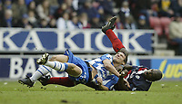 Photo: Aidan Ellis.<br /> Wigan Athletic v West Bromwich Albion. The Barclays Premiership. 15/01/2006.<br /> Wigan's Lee McCulloch feels the challenge from West Brom's Darren Moore