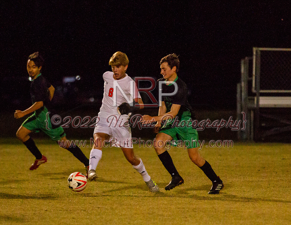 #8 Ted Foster moves past the Irish defender during their game against Bishop McGuinness on April 24, 2018.