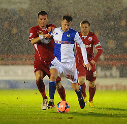 Bristol Rovers' Ollie Clarke holds of Crawley Town's Andy Drury - Photo mandatory by-line: Seb Daly/JMP - Tel: Mobile: 07966 386802 18/12/2013 - SPORT - FOOTBALL - Broadfield Stadium - Crawley - Crawley Town v Bristol Rovers - FA Cup - Replay