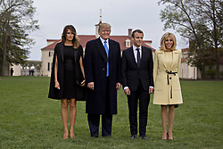U.S. First Lady Melania Trump, from left, U.S. President Donald Trump, Emmanuel Macron, France's president, and Brigitte Macron, France's first lady, stand for photographers outside the Mansion at the Mount Vernon estate of first U.S. President George Washington in Mount Vernon, Virginia, U.S., on Monday, April 23, 2018. As Macron arrives for the first state visit of Trump's presidency, the U.S. leader is threatening to upend the global trading system with tariffs on China, maybe Europe too. Photographer: Andrew Harrer/Bloomberg