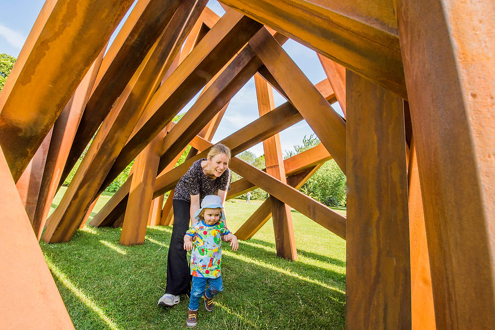 Orli, aged 2, enjoys playing with her mum in Bernar Venet's 11 Acute Unequal Angles (2016) - The Frieze Sculpture Park 2017 comprises large-scale works, set in the English Gardens . The installations will remain on view until 8 Oct 2017.