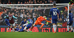 West Ham United's Javier Hernandez (second left) scores his team's first goal of the game during the Premier League match at Stamford Bridge, London.