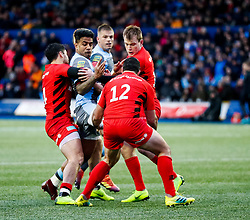 Rey Lee-Lo of Cardiff Blues under pressure from Sean Maitland of Saracens<br /> <br /> Photographer Simon King/Replay Images<br /> <br /> European Rugby Champions Cup Round 4 - Cardiff Blues v Saracens - Saturday 15th December 2018 - Cardiff Arms Park - Cardiff<br /> <br /> World Copyright © Replay Images . All rights reserved. info@replayimages.co.uk - http://replayimages.co.uk