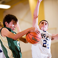 112912       Cable Hoover<br /> <br /> Thoreau Hawk Alfred Smith (21) grabs a rebound away from Santa Fe Prep Griffin DJ Casados (22) during the Rehoboth Invitational Thursday at Rehboth High School.