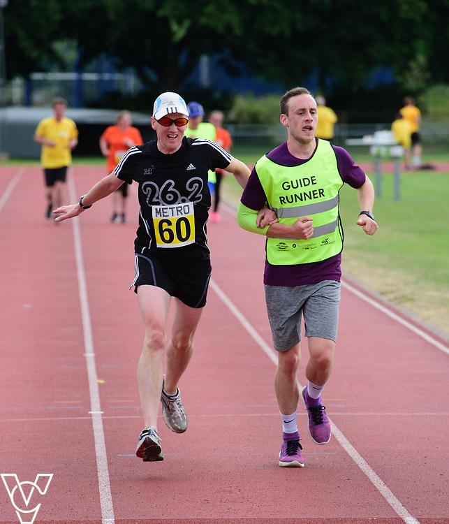 Event: 5000 meter relay<br /> Competitors, from left: Andrew Jones<br /> <br /> Metro Blind Sport's 42nd Athletics Open, held at Mile End Stadium, Tower Hamlets, London.<br /> <br /> Picture: Chris Vaughan Photography for Metro Blind Sports<br /> Date: June 16, 2018