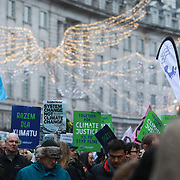 The Together for Climate Justice demonstration and march ahead of the COP24 summit in Poland, December 01, Central London, United Kingdom. Thousands gathered outside the Polish embassy ahead of the march listening to various speakers. The march went down through Regent Street and the central shopping districts of London via Trafalgar Sqaure to  Downbing Street in Whitehall.