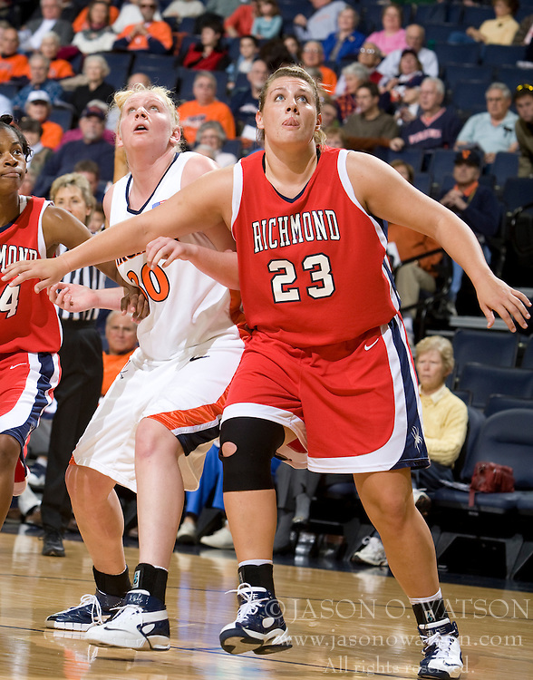 Richmond forward Katie Holzer (23) boxes out Virginia forward/center Abby Robertson (30) on a free throw attempt.  The Virginia Cavaliers women's basketball team faced the Richmond Spiders at the John Paul Jones Arena in Charlottesville, VA on November 18, 2007.