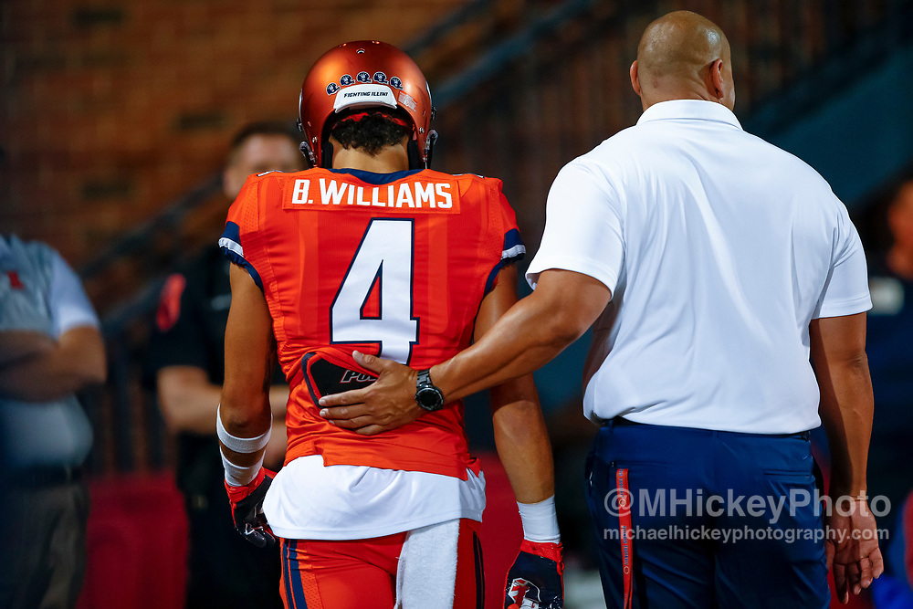 CHAMPAIGN, IL - SEPTEMBER 29: Bennett Williams #4 of the Illinois Fighting Illini is escorted to the locker room after being disqualified for targeting during the game against the Nebraska Cornhuskers at Memorial Stadium on September 29, 2017 in Champaign, Illinois. (Photo by Michael Hickey/Getty Images) *** Local Caption *** Bennett Williams