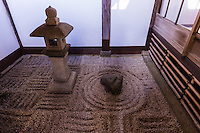 """Shinnyo-do was founded in 984 by priest Kaisan to enshrine a statue of Buddha of Paradise. The temple became famous as a training centre where one can practice the """"Fudan Nenbutsu"""", a prayer to Buddha that lasts all day without any pause, a tradition evolved into """"O-juja"""" a 10 day chanting prayer that is still performed every year.  Many famous people and families are buried in the temple.  Leaving the main hall, a covered path leads to two gardens.   The first is the Nehan """"Nirvana"""" garden and was built in the classic karesansui rock garden style in 1988. It uses the borrowed andscape technique to include Mt. Hiei in its design. The second garden was designed by Shigemori Chisao - Its geometrical pattern is similar in design to his father Shigemori Mirei works at Tofuku-ji and elsewhere."""