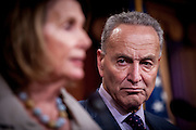 Senator Chuck Schumer (D-NY) looks on as House Minority Nancy Pelosi (D-CA) speaks to the media about ongoing budget negotiations with the Republican majority during a press conference on Capitol Hill in Washington, D.C., on October 1, 2015.