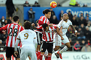 Southampton's Virgil Van Dijk (c) wins the header from Swansea's Andre Ayew (r). Barclays Premier league match, Swansea city v Southampton at the Liberty Stadium in Swansea, South Wales on Saturday 13th February 2016.<br /> pic by  Carl Robertson, Andrew Orchard sports photography.