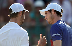 Australia's Jordan Thompson (left) shake hands with Great Britain's Andy Murray after winning their match on day two of the 2017 AEGON Championships at The Queen's Club, London.