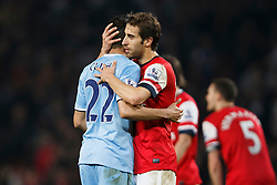 Man City Defender Gael Clichy (FRA) hugs Arsenal Goalscorer Mathieu Flamini (FRA) after the game finishes in a 1-1 draw - Photo mandatory by-line: Rogan Thomson/JMP - 07966 386802 - 29/03/14 - SPORT - FOOTBALL - Emirates Stadium, London - Arsenal v Manchester City - Barclays Premier League.