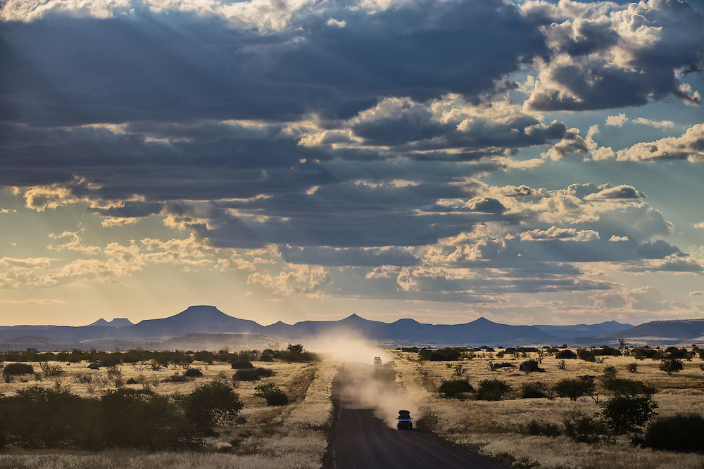 4x4 Self drive vehicles kick up dust as they travel down the C39 road to the east.