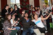 """Sky Radio Christmas Tree for Charity 2011 in Artis, Amsterda.<br /> <br /> Op de foto:  Danielle Oerlemansen Christophe Haddad hadden als """"versiering""""kinddren uit Artis/Park gehaald voor hun S.O.S. kinderdorpen boom"""