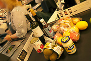 Goods at the supermarket checkout.