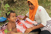 ACEH, INDONESIA - MAY 14: <br /> <br /> Daily Life of Rohingya Migrant in New Shelter<br /> <br /> Rohingya migrants of Bangladesh and Myanmar are seen outside at new temporary shelter on May 13, 2015 in Lhoksukon, Aceh province, Indonesia. Boats carrying over 500 of Myanmar's Rohingya refugees have arrived in Indonesia, many requiring medical attention. They have warned that thousands more are thought to be still at sea. Myanmar's Rohingya Muslim community have long been persecuted and marginalized by Myanmar's mostly Buddhist population.<br /> ©Reza Juliansya/Exclusivepix Media