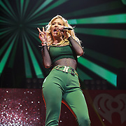 """WASHINGTON, DC - December 15th, 2014 - Iggy Azalea  performs onstage during HOT 99.5's Jingle Ball 2014 at the Verizon Center in Washington, D.C. Her single """"Fancy"""" reached number one on the Billboard Hot 100. (Photo By Kyle Gustafson / For The Washington Post)"""