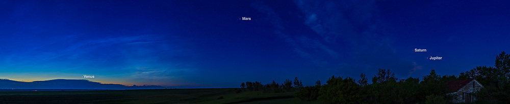 Four naked-eye planets arrayed across the dawn sky on July 4, 2020: Venus to the left, Mars at centre, and the pairing of Saturn and Jupiter at right above the old house. Noctilucent clouds light northeastern sky at left, while normal clouds are at right. Mercury was too close to the Sun to see at this time. <br /> <br /> This is a panorama of 12 segments with the 35mm lens and Canon 6D MkII stitched in two parts with Adobe Camera Raw.
