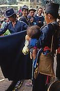 Lao Hmong buy customary black cloth at market in Luang Prabang