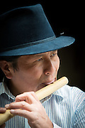 Jose Luis Fichamba plays a flute, made from bamboo in his workshop, Peguche , Otavalo, Ecuador, South America