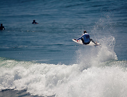 HUNTINGTON BEACH, California/USA (Friday,Aug 5, 2011) 10-Time ASP World Champion Kelly Slater (Cocoa Beach, FL), 39, performs a spectacular aerial during his heat friday at noon at  the U.S. Open of Surfing 2011. Photo: Eduardo E. Silva.