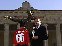 Fotball<br /> Foto: BPI/Digitalsport<br /> NORWAY ONLY<br /> <br /> 12/10/2004 Statue unveiling, Tofiq Bahramov Stadium<br /> Sir Geoff Hurst unveils the statue in honour of the Azerbaijan linesman, standing alongside his grandson, also named Tofiq, sporting a Bahramov 66 t shirt