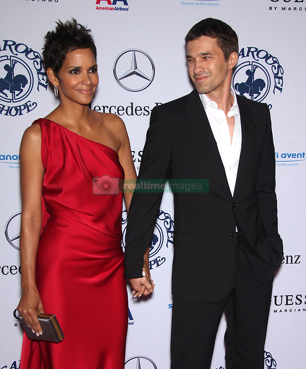 Halle Berry & Olivier Martinez arrives for the Carousel of Hope at the Beverly Hilton Hotel. (Credit Image: © Lisa O'Connor/ZUMApress.com)